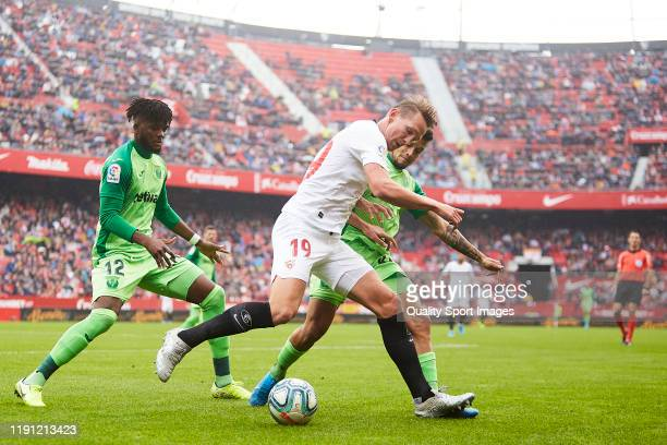 Luuk de Jong of Sevilla FC competes for the ball with Unai Bustinza and Awaziem of CD Leganes during the Liga match between Sevilla FC and CD Leganes...