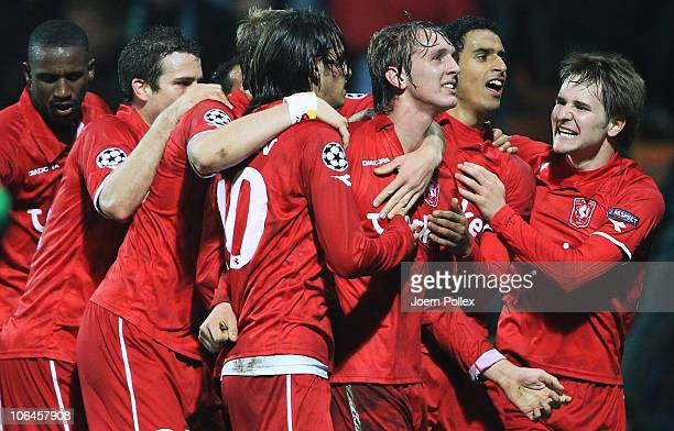 Luuk de Jong of Twente celebrates with his team mates after scoring his team's second goal during the UEFA Champions League group A match between SV...