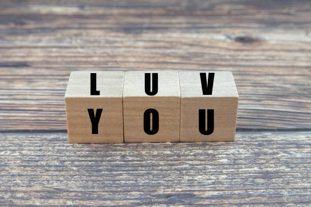 Luv You or Love You Word on Wooden Block. Concepts, Feelings, Emotion and Backgrounds.