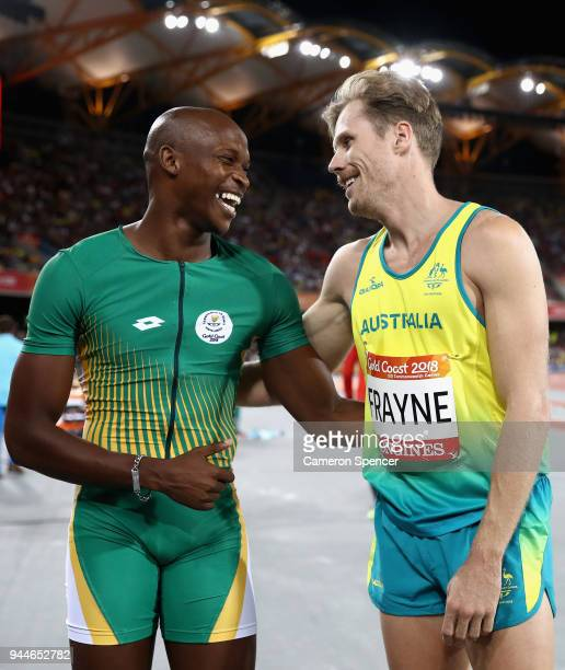 Luvo Manyonga of South Africa celebrates winning gold with silver medalist Henry Frayne of Australia in the Men's Long Jump final during athletics on...