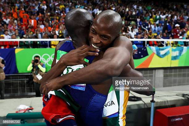 Luvo Manyonga of South Africa celebrates with Jeff Henderson of the United States after the Men's Long Jump Final on Day 8 of the Rio 2016 Olympic...
