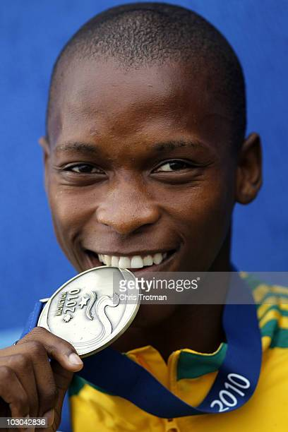 Luvo Manyonga of South Africa receives receives his gold medal for finishing first in the Long Jump Final on Day 4 of the 13th IAAF World Junior...