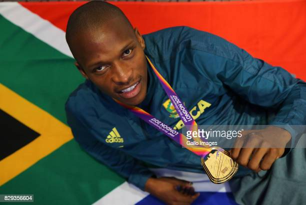 Luvo Manyonga poses with his gold medal at an Athletics South Africa press conference at the Grange Tower Hotel on August 10 2017 in London United...