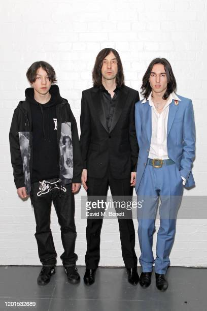 Lux Gillespie, Bobby Gillespie and Wolf Gillespie attend the Burberry Autumn/Winter 2020 show during London Fashion Week at Kensington Olympia on...