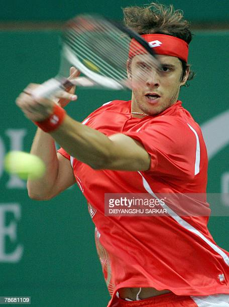 Luxemberg tennis player Gilles Muller plays a return to his Belgian opponent Xavier Malisse during their first round match at The ATP Chennai Open...