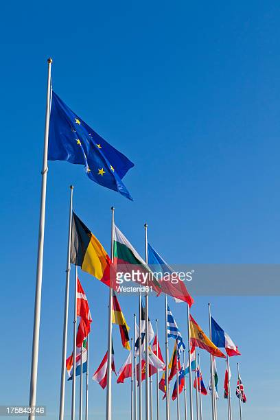 Luxembourg, European flags against sky