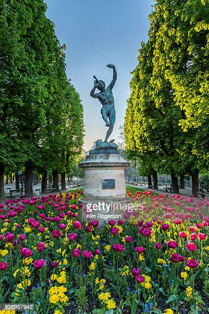 Luxembourg Gardens displays the bronze statue of Faune Dansant with a bed of tulips below