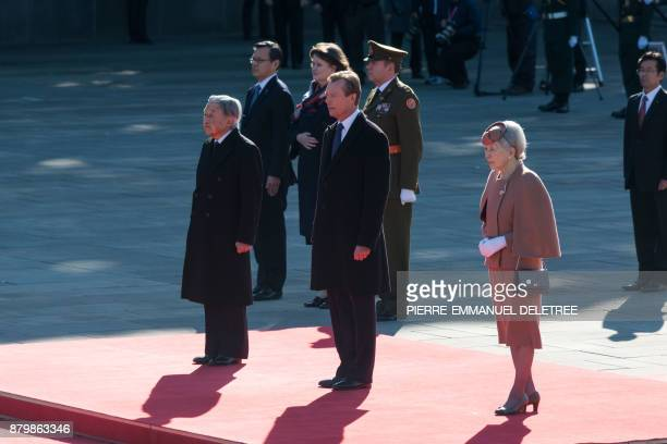 Luxembourg Grand Duke Henri listens to national anthems with Japanese Emperor Akihito and Empress Michiko during his welcoming ceremony at the...