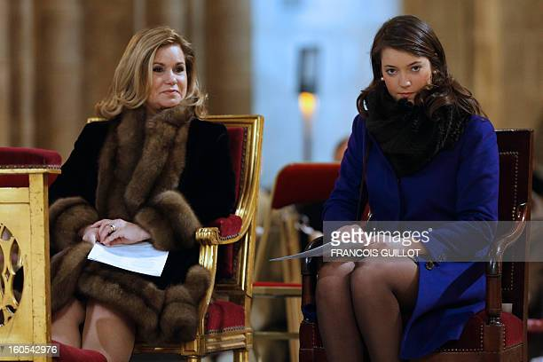 Luxembourg GrandDuchess Maria Teresa and her daughter Princess Alexandra attend a mass at Paris' NotreDame de Paris Cathedral during which the...