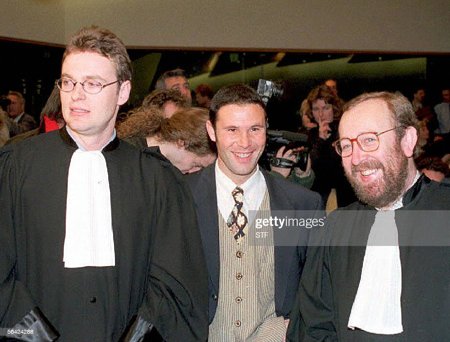 Belgian soccer player Jean-Marc Bosman, flanked by two of his lawyers Luc Misson (R) and Jean-Louis Dupont (L), smiles as the European Court of Justice rules 15 December 1995 that the transfer system of players between football clubs was illegal. The ruling of the European Court of Justice in December 1995 upheld the case brought by Jean-Marc Bosman against the European football authorities as a result of his failed transfer from a Belgian to a French club in 1990. The repercussions spread quickly through western European football as the European Union demanded that regulations concerning players' transfers and limitations on foreign players be amended almost immediately.