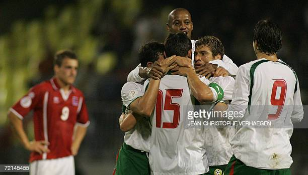 Bulgarian players jubilate after scoring a goal versus Luxembourg during the Euro 2008 qualification match at Josy Barthel Stadium 11 October 2006 in...