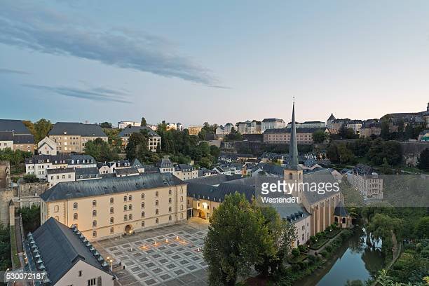 Luxembourg, Luxembourg City, View to Neumuenster convent at Alzette river and the city in the evening