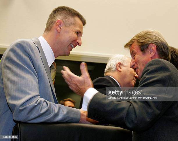 Luxembourg, LUXEMBOURG: French Foreign minister Bernard Kouchner chats with his Latvian counterpart Artis Pabriks at the start of a general affairs...