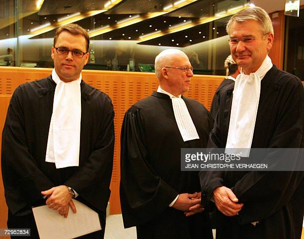 Latvian firm Laval Un Partneri's lawyers Anders Elmer and Martin Agell pose beside Swedish government representative lawyer Anders Kruse at the start...