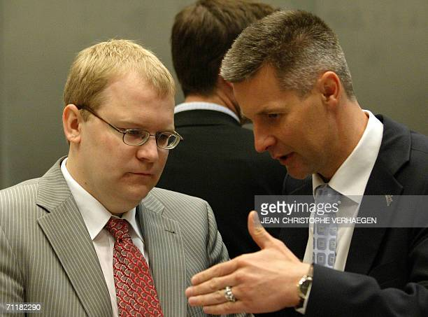 Latvian Foreign Minister Artis Pabriks speaks with his Estonian counterpart Urmas Paet 12 June 2006 before a Foreign Affairs Council meeting at EU...
