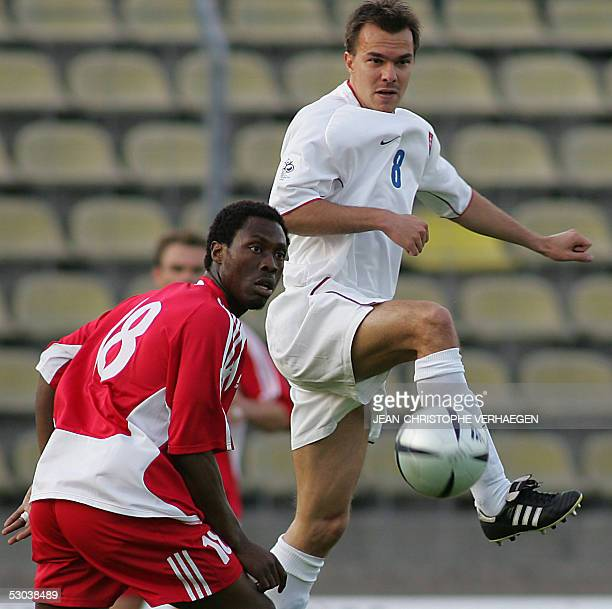 Luxembourg's Martin Jakubko fights for the ball with Slovakia's Szilard Nemeth during their World Cup 2006 european zone group 3 qualifying football...