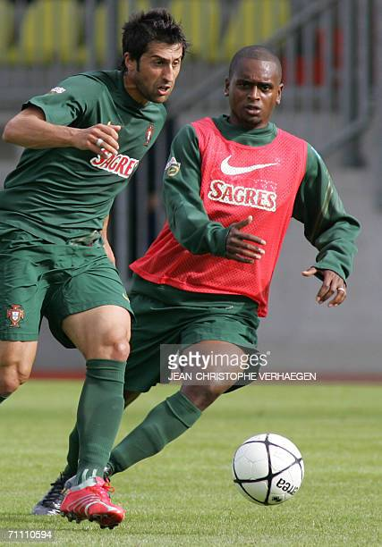 Portugal's defender Miguel fights for the ball with Marco Caneira during a training session of Portugal football team at Josy Barthel Stadium 2 June...