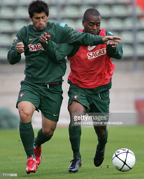 Portugal's defender Miguelfights for the ball with Marco Caneira during a training session of Portugal football team at Josy Barthel Stadium 2 June...