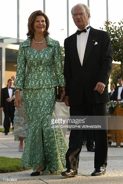 Queen Silvia of Sweden and King Carl Gustav of Sweden arrive at the Grand Theater to attend a special performance for Grand Duke Henri of Luxembourg...