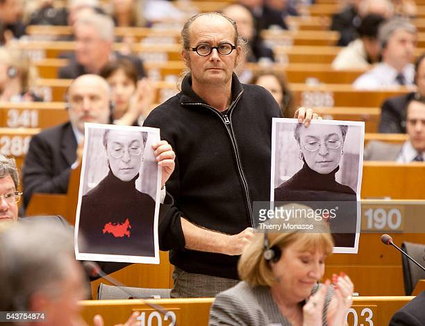 Luxembourg Member of the European Parliaments Group of the Greens/European Free Alliance Claude TURMES show a pictured of the killed Anna...