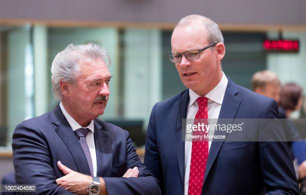 Luxembourg Minister of Foreign Affairs Immigration Jean Asselborn is talking with the Irish Minister for Foreign Affairs Trade Simon Coveney prior an...