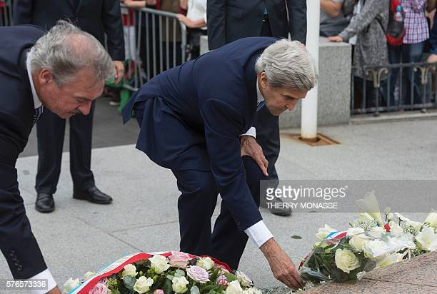 Luxembourg Minister of Foreign Affairs Jean Asselborn and US Secretary of State John Kerry lay white roses as they pay tribute to the victims of the...