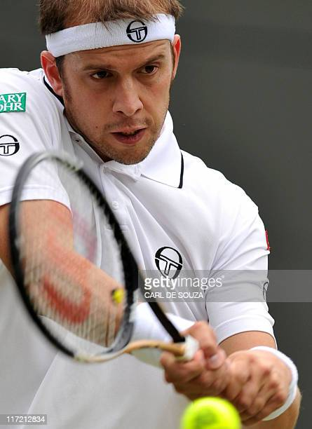 Luxembourg player Gilles Muller returns the ball to Spanish player Rafael Nadal during the men's single at the Wimbledon Tennis Championships at the...