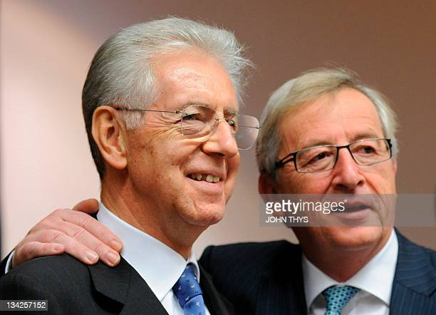 Luxembourg Prime minister and chairman of the Eurogroup Jean Claude Juncker speaks with Italian Finance Minister Mario Monti on November 29 2011...