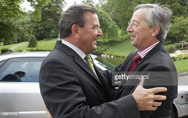 Luxembourg Prime Minister and current European Union president JeanClaude Juncker greets German Chancellor Gerhard Schroeder 02 June 2005 in...