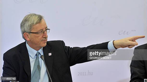 Luxembourg Prime Minister and Eurogroup President JeanClaude Juncker gestures on April 8 2011 during a press conference after an informal meeting of...