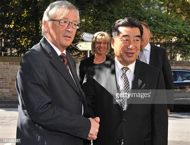 Luxembourg Prime Minister and Eurogroup president JeanClaude Juncker welcomes China Vice Prime minister Hui Liangyu priorto a lunch working session...