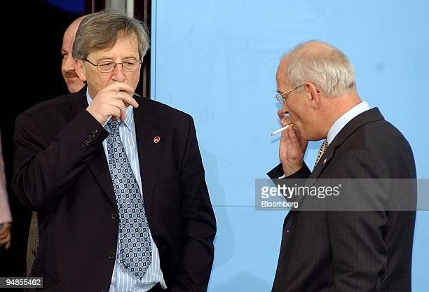 Luxembourg Prime Minister and Finance Minister JeanClaude Juncker left joins Dutch Finance Minister Gerrit Zalm for a smoke outside the European...