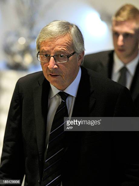 Luxembourg prime minister JeanClaude Juncker arrives to give a statement at the Alvisse Hotel in Luxembourg on October 20 2013 in Luxembourg The...