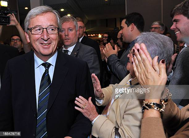 Luxembourg prime minister JeanClaude Juncker is greeted by fans as he arrives to the Alvisse Hotel in Luxembourg on october 20 2013 in Luxembourg The...