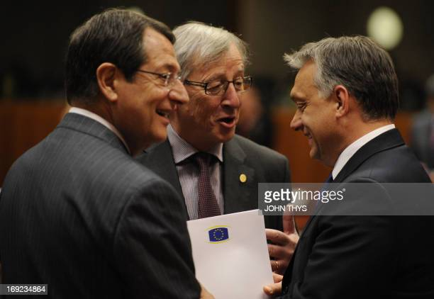 Luxembourg Prime Minister JeanClaude Juncker talks with Greek Prime Minister Antonis Samaras and Hungarian Prime Minister Viktor Orban during a...