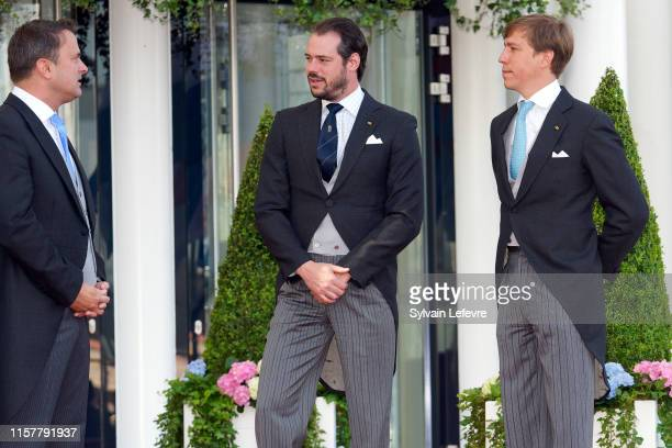 Luxembourg Prime Minister Xavier Bettel Prince Felix of Luxembourg and Prince Louis of Luxembourg arrive at the Philharmonie for the concert on the...