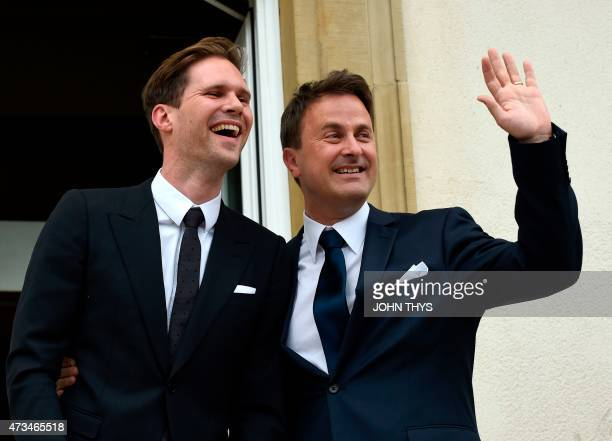 Luxembourg Prime Minister Xavier Bettel waves next to his companion Belgian architect Gauthier Destenay during their wedding in Luxembourg on May 15...