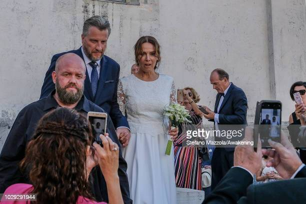 Luxembourgborn actress Desiree Nosbusch and German cameraman Tom Alexander Bierbaumer exit from the church of Oderzo after their marriage on...