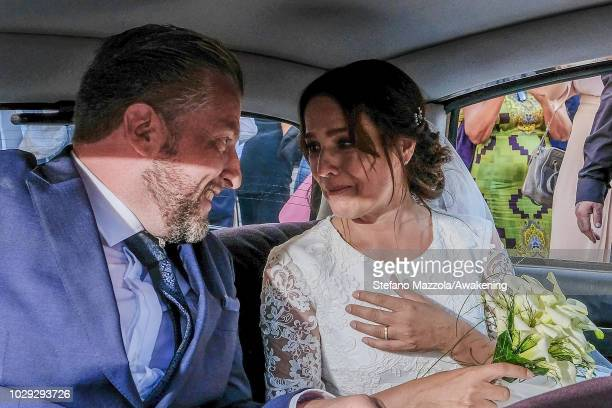 Luxembourgborn actress Desiree Nosbusch and German cameraman Tom Alexander Bierbaumer sit in a car as the leave the church following their marriage...