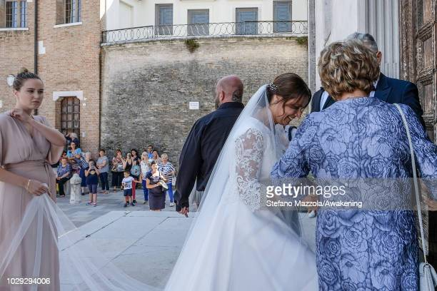 Luxembourgborn actress Desiree Nosbusch enters the church of Oderzo during her marriage to German cameraman Tom Alexander Bierbaumer on September 8...