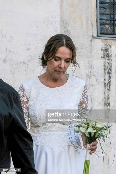 Luxembourgborn actress Desiree Nosbusch exits from the church of Oderzo after their marriage on September 8 2018 in Oderzo Italy