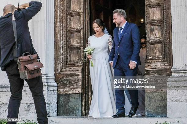 Luxembourgborn actress Desiree Nosbusch wearing a dress by MINX and German cameraman Tom Alexander Bierbaumer exit from the church of Oderzo after...