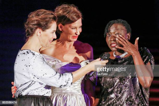 Luxembourgian presenter Desiree Nosbusch Minx Designer Eva Lutz and Auma Obama halfsister of former US president Barack Obama during the Minx Fashion...