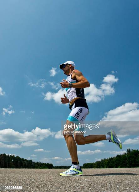 Luxembourgish triathlete DirkBockel races during the running stage of the Datev Challenge Roth inSchwandGermany 14 July 2013 Triathlon...