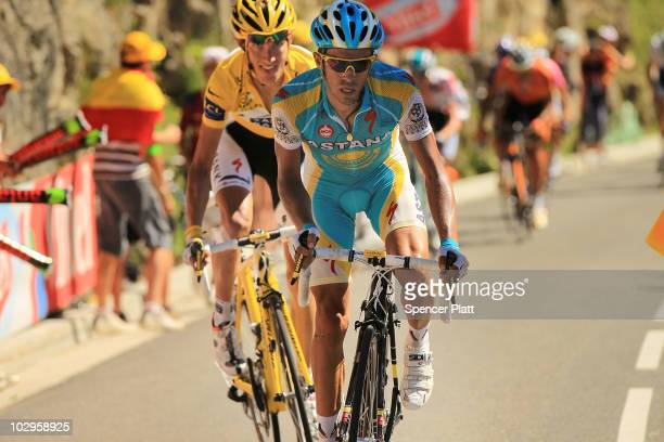 Luxembourg's Andy Schleck in the yellow jersey chases Spain�s Alberto Contador on the final climb of Stage 14 of the Tour de France the first stage...