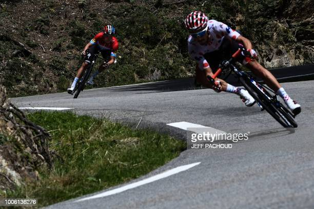 Luxembourg's Bob Jungels and France's Julian Alaphilippe descend with a 12-men breakaway group the Col d'Aspin pass during the 19th stage of the...