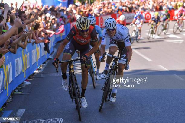 Luxembourg's Bob Jungels of team QuickStep sprints to the finish line next to Italy's rider of team Bahrain Merida Vincenzo Nibali during the 15th...