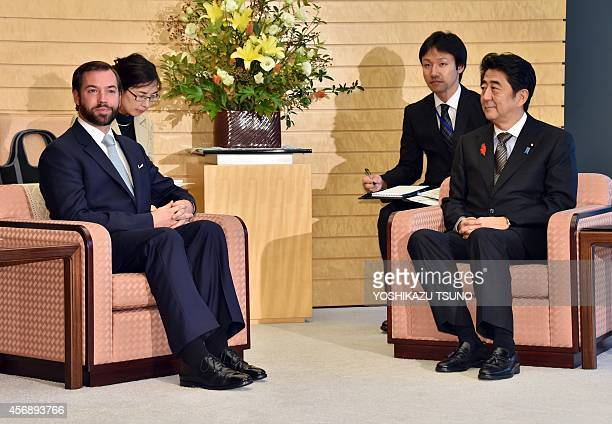 Luxembourg's Crown Prince Guillaume talks with Japanese Prime Minister Shinzo Abe at Abe's office in Tokyo on October 9 2014 Crown Prince Guillaume...