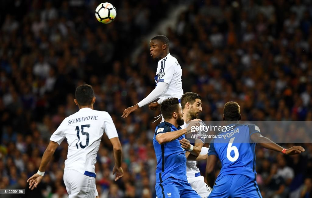 Luxembourg's defender Christopher Martins Pereira (Top) heads the ball next to France's forward Olivier Giroud (C) during the FIFA World Cup 2018 qualifying football match France vs Luxembourg on September 3, 2017 at the Municipal Stadium in Toulouse, southern France. /