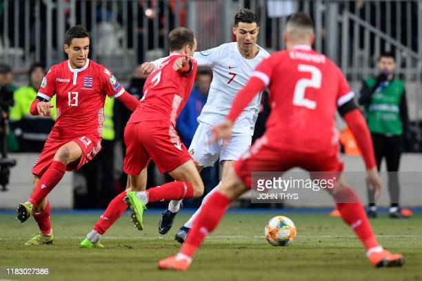 Luxembourg's defender Dirk Carlson vies with Portugal's forward Cristiano Ronaldo during the UEFA Euro 2020 Group B qualification football match...